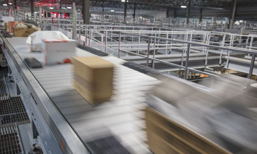 Packages being transported on a conveyor belt